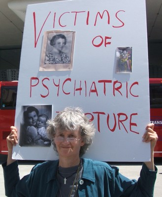 Molly Hogan supporting victims of psychiatric torture.
