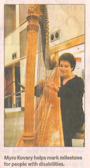 Myra Kovary playing harp at United Nations celebration