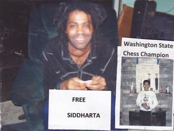 image of Siddhartha, a smiling, dark-skinned woman with long dreadlocks.